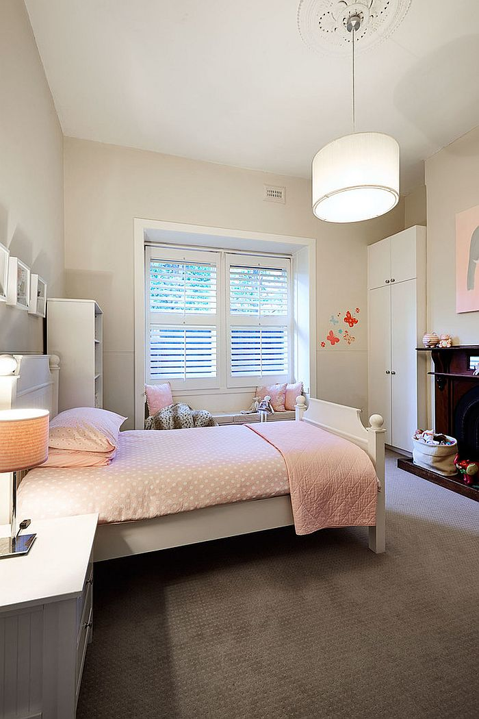 Lovely use of soft pink in the traditional bedroom