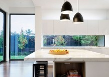 Marble-kitchen-island-tops-pays-tribute-to-the-rich-heritage-of-the-home-217x155