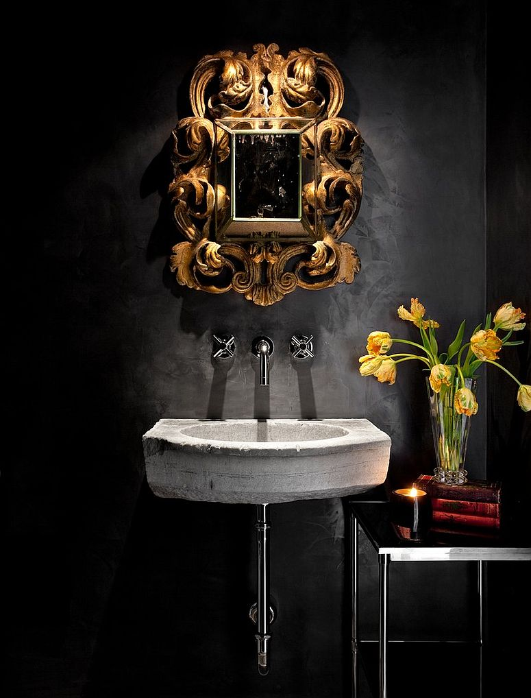 Mediterranean powder room with a black backdrop and stone sink [Design: Ryan Street & Associates]