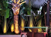 Miami patio with illuminated tropical foliage 217x155 10 Backyard Getaways with Landscape Lighting