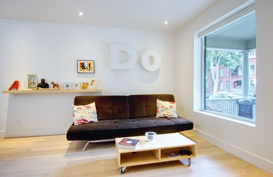 Midcentury family room with a trendy coffee table [From: Andrew Snow Photography]
