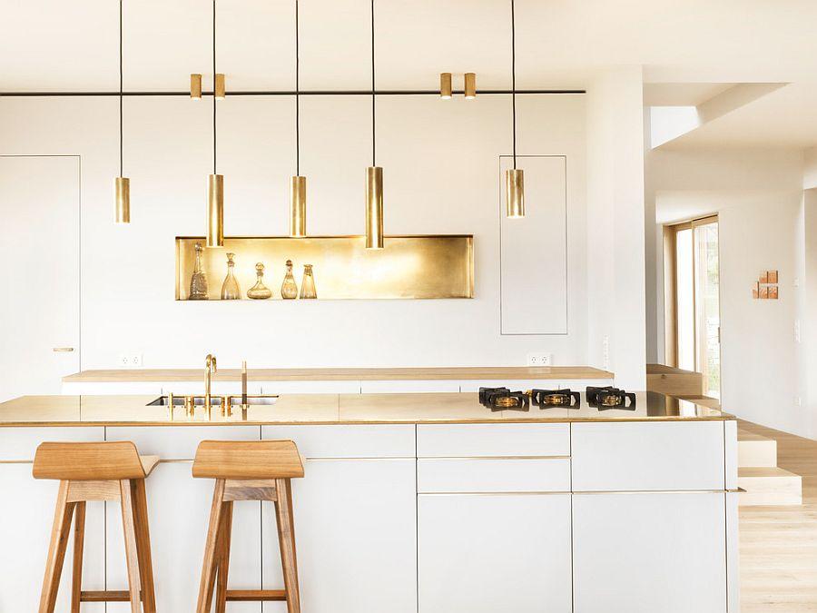 Minimal kitchen with awesome golden aura [Design: Studio Mierswa-Kluska]
