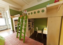 Mirrored loft beds in green room