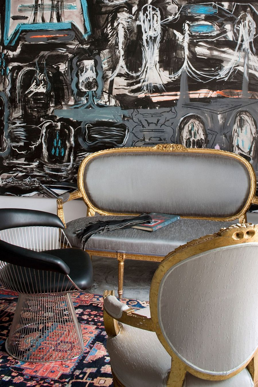 Modern art combined with traditional decor to shape an eclectic interior