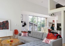 Modern living area with workstation in the corner