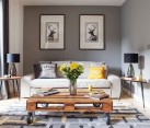 Modern living room in gray with pops of yellow