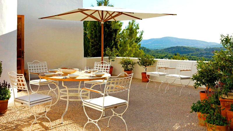 This Italian patio makes good use of an updated wrought iron set