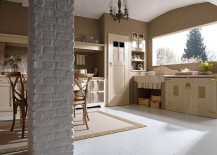 Natural stone and soothing colors shape the country kitchen