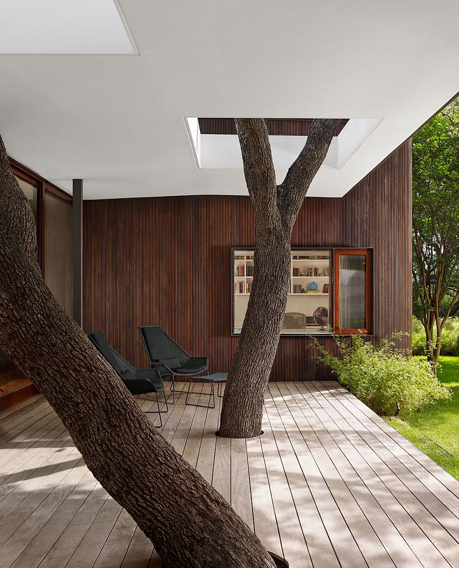 Old trees become an integral part of the structure of the modern Texas home