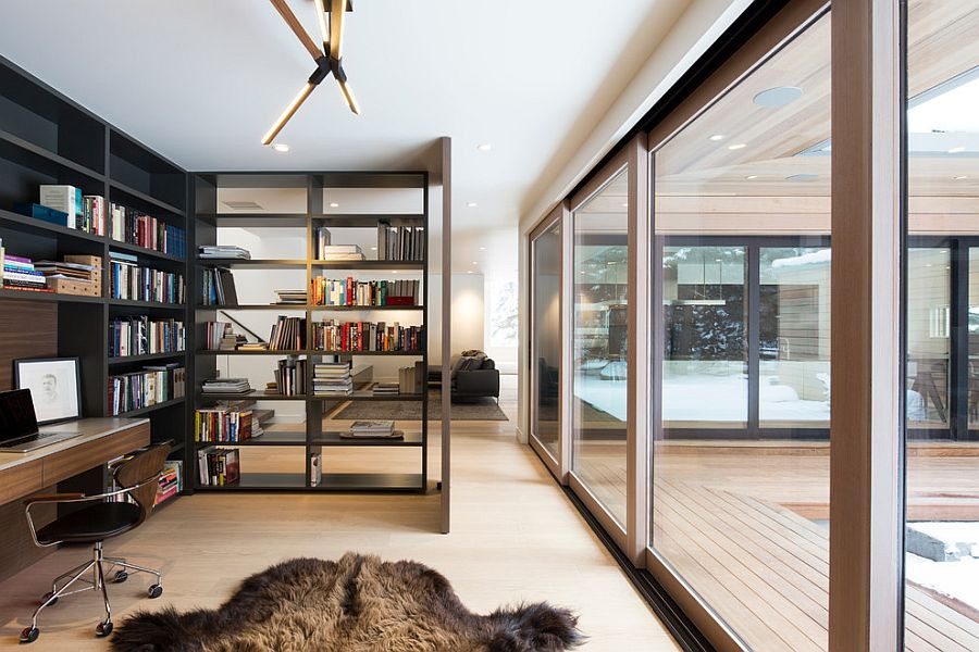 open space home office. open bookshelf adds as a divider between the home office and living room design space e