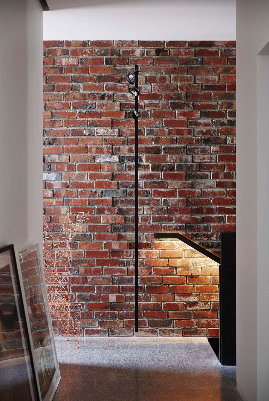 Original brick wall of the house exposed to give it a loft-like appeal