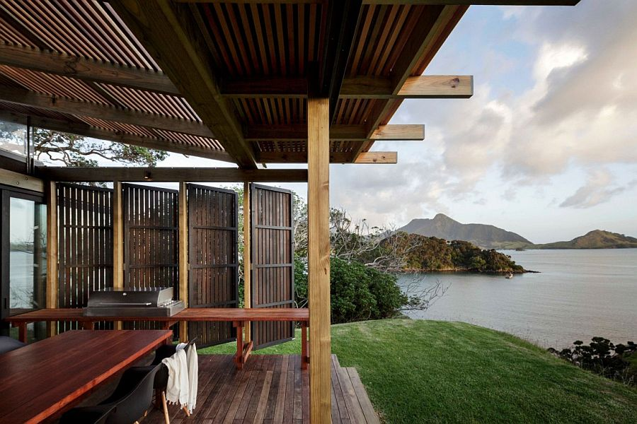 Outdoor pavillion with large wooden doors that offers unabated sea views