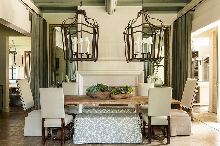 Oversized lighting fixtures in the dining room [Design: McAlpine Tankersley Architecture]