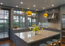 Pendants bring pops of yellow to the classy gray kitchen