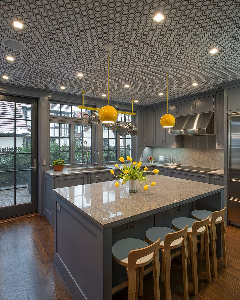 View in gallery Pendants bring splashes of yellow to the classy gray kitchen  [Design: Essential Design +
