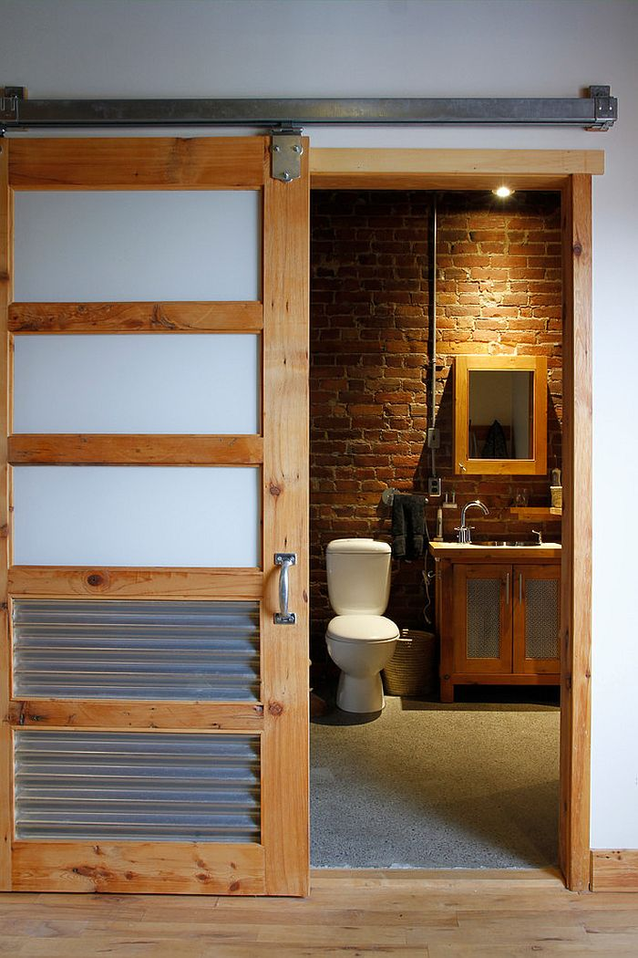 15 sliding barn doors that bring rustic beauty to the bathroom for Bathroom entrance doors