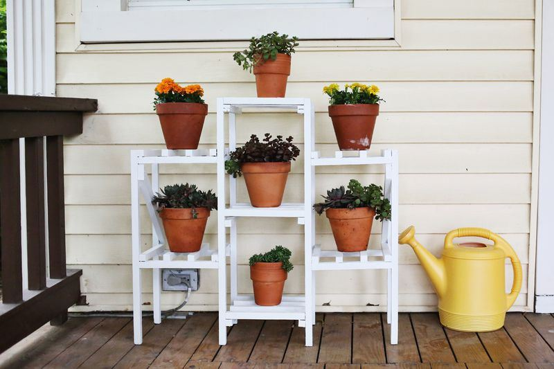 Plant shelf on a front porch