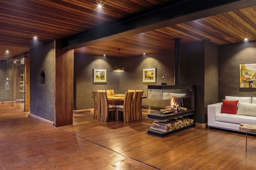 Plastered walls and a neutral color palette create dark, moody vibe
