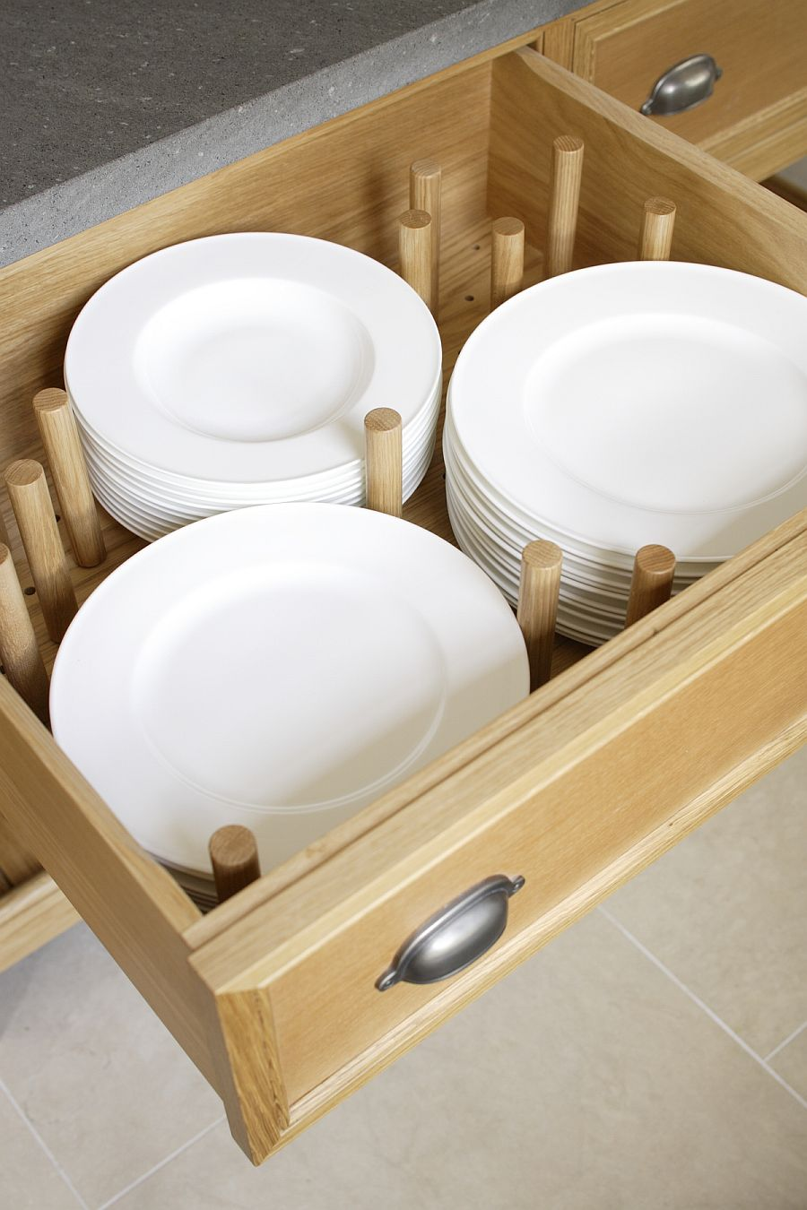Plate drawer in the kitchen island that can be tucked away with ease