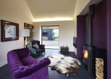Plush purple sofa adds to the opulence of the interior