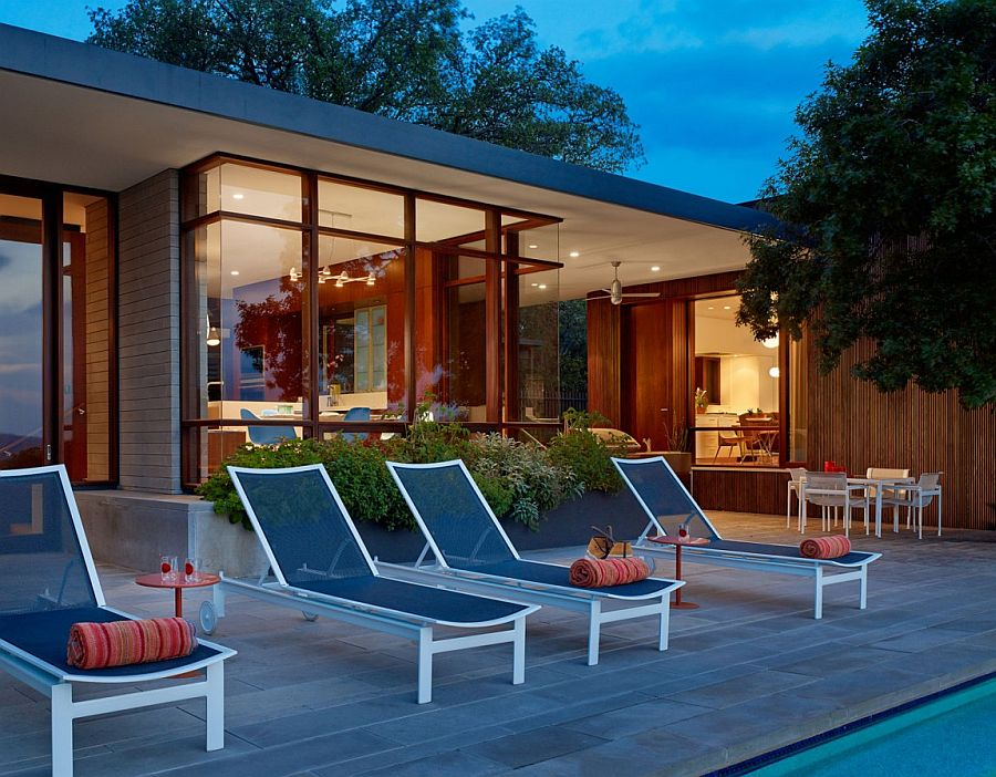 Poolside loungers in blue add color to the setting