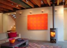 Pops of bright orange enliven the industrial living room