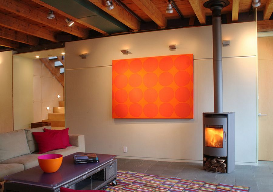 Pops of bright orange enliven the industrial living room [Design: Studio One-Off Architecture & Design]
