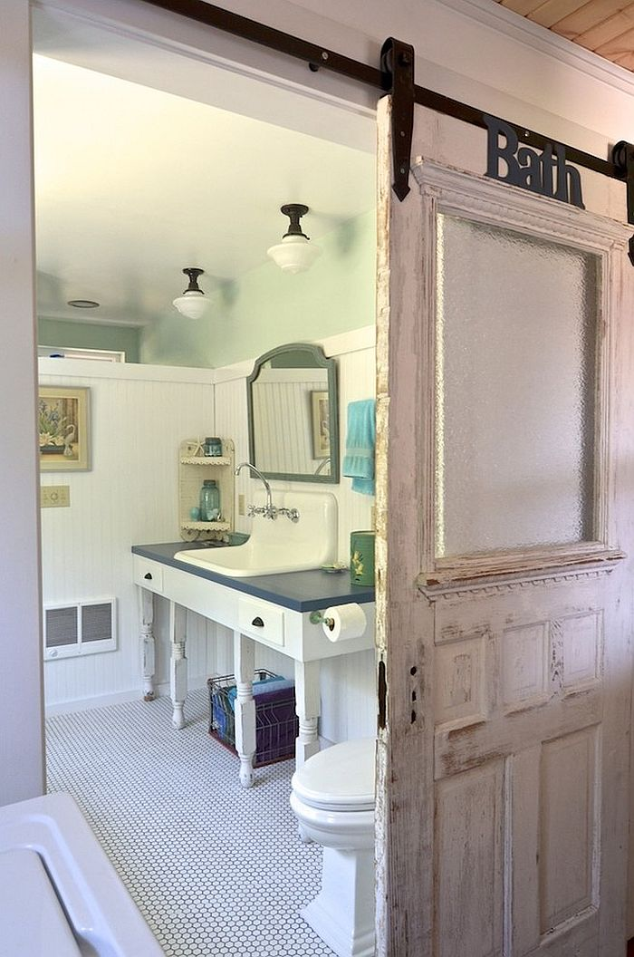 Reclaimed barn door for the traditional bathroom  From  Sarah Greenman. 15 Sliding Barn Doors That Bring Rustic Beauty to the Bathroom