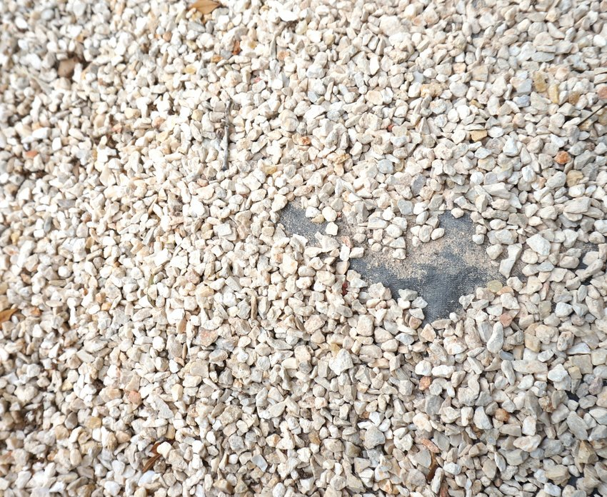 Redistribute gravel to cover bare spots