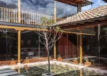 River rock and Arupo tree shape the stunning central counrtyard of the Cuenca Home
