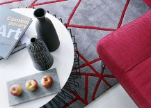 Rug in gray and red complements the color scheme of the living room