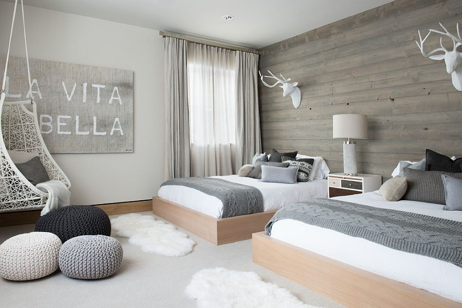 Scandinavian bedroom with wooden accent wall and pops of gray [Design: Reed Design Group]