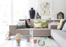 Scandinavian living room with glass coffee table on wheels