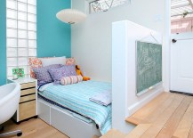 Sculptural lighting and color scheme add to the elegance of the small kids' bedroom