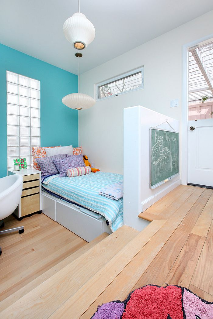 Sculptural lighting and color scheme add to the elegance of the small kids' bedroom [Design: V.I.Photography & Design]