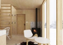 Simple wooden surfaces and decor shape the interior of the minimal winter retreat