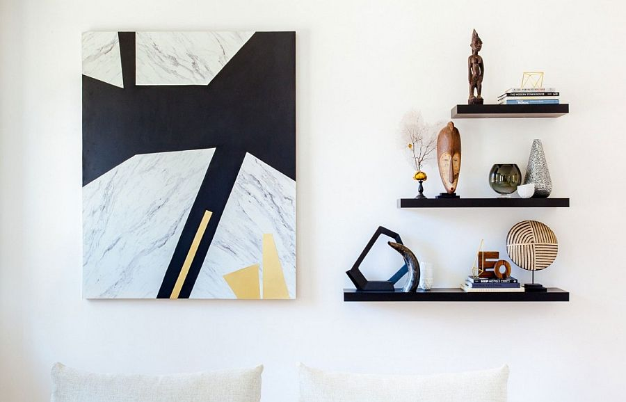 Sleek floating shelves and captivating wallart in the living space