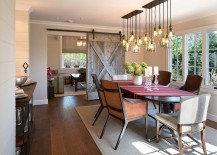 Sliding barn door and brilliant lighting steal the show in this dining room