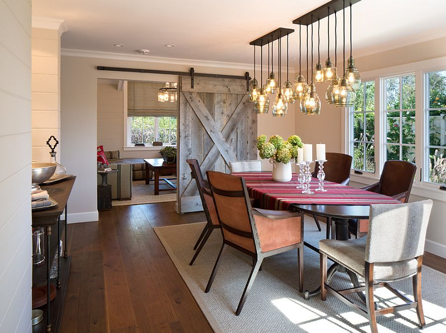 Sliding barn door and brilliant lighting steal the show in this dining room [Design: Anne Sneed Architectural Interiors]