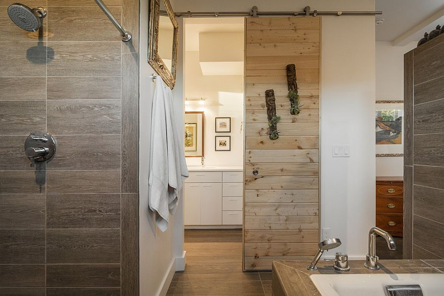 Sliding barn door saves up space in the small contemporary bathroom [From: Lucy Call Photography]