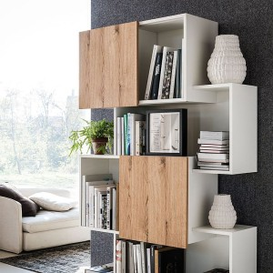 Sliding doors of the bookshelf give it a dynamic appeal