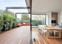 Sliding-glass-doors-connect-the-new-living-area-with-the-wooden-deck-outside-217x155