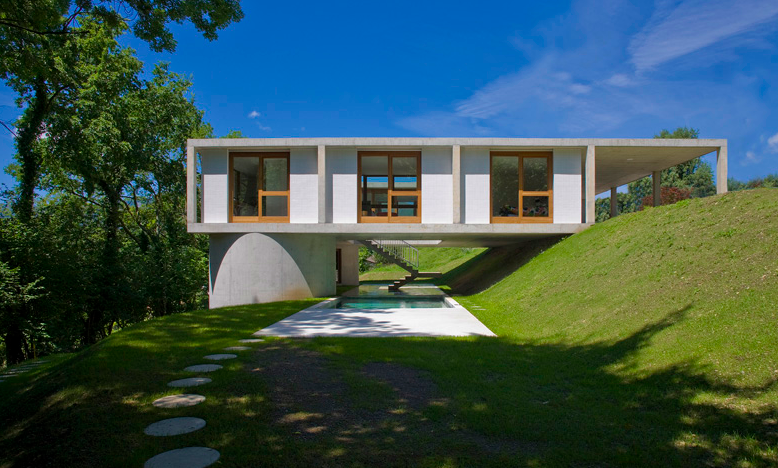 This design proves you can still have a sizable home with just one floor while still minimizing footprint
