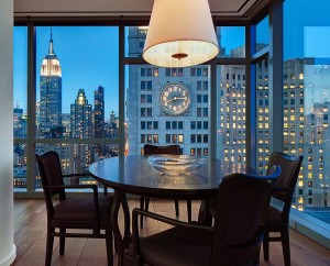 Small dining space in the corner with New York City's sparkling skyline as backdrop