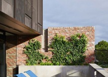 Small-private-porch-of-the-melbourne-how-with-a-brick-backdrop-and-colorful-loungers-217x155