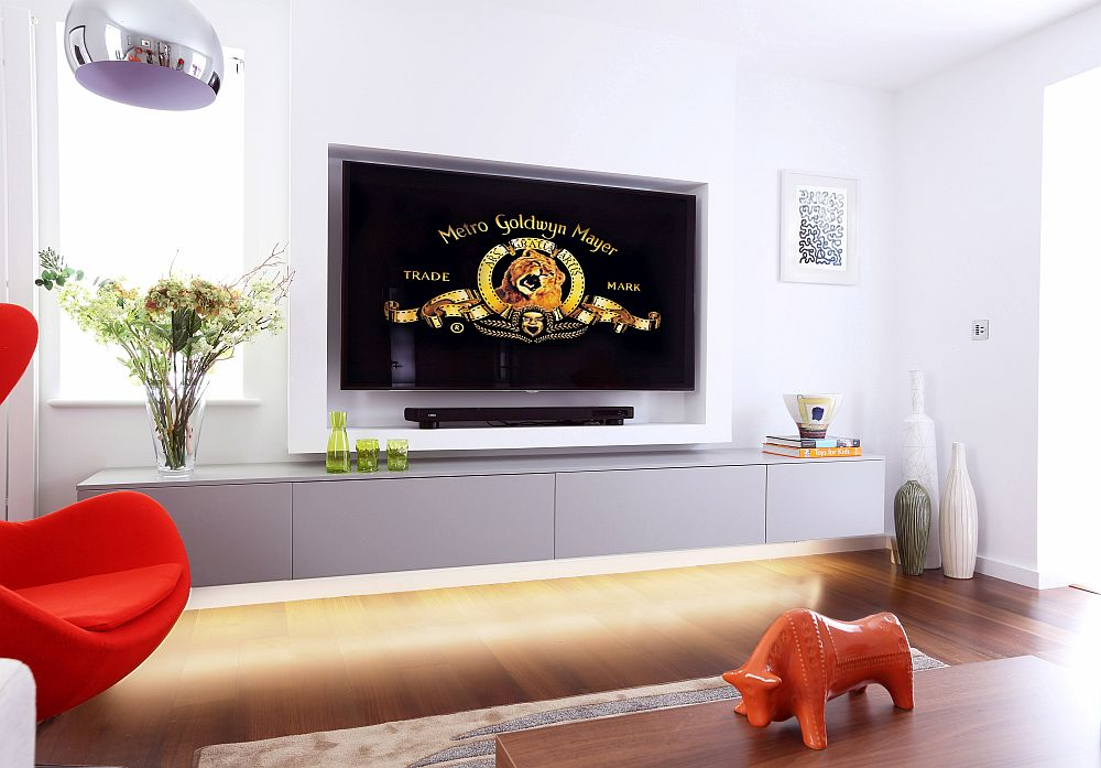 Smart Tv room design with ample ventilation, plush setaing and 65-inch LED TV