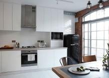Smart white kitchen with tiled backsplash