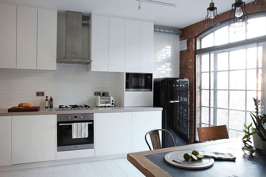 Smart white kitchen with tiled backsplash