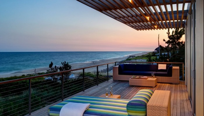 Huge oceanfront decks take advantage of the site's natural beauty