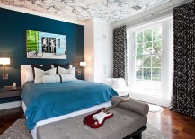 Splatter paint in three different colors creates a trendy ceiling in the teen bedroom